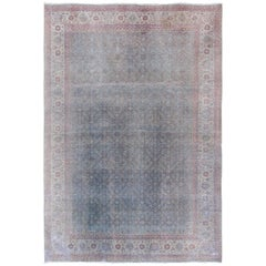 Faded All-Over Floral Vintage Persian Tabriz Rug in Shades of Blue and Red