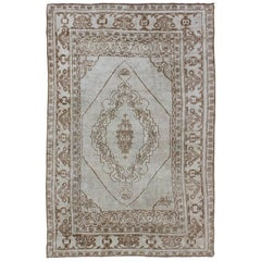 Muted Turkish Oushak Carpet with Traditional Floral Medallion Design