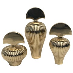 Set of Three Brass Perfume Bottles