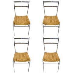 Four Gio Ponti Style Chrome and Grass Seat Chairs