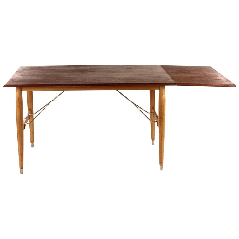 Swedish Teak Table with birch legs and frame of stainless steel
