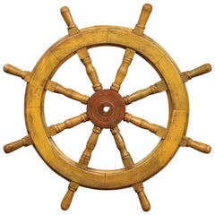 19th Century French Carved Walnut and Iron Sailboat Wheel with Old Yellow Paint