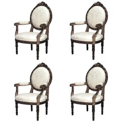 Set of Four French Louis XVI Style Gilt Carved Armchairs