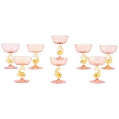 Eight Handblown Venetian/Murano Pink Rose Champagne Coupes with Figural Dolphins