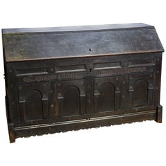 Antique Hand-Carved English Trunk of Ebonized Oak with Forged Iron Handles