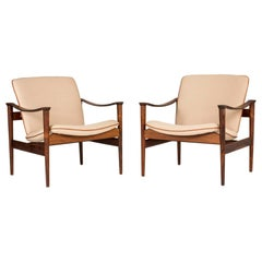 Pair of Rosewood Lounge Chairs by Fredrik Kayser
