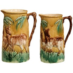 Pair of 19th Century French Hand-Painted Barbotine Wine Pitchers with Deer
