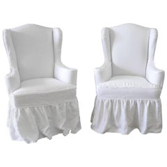 Pair of Modern White Linen Slip Covered Wingback Chairs with Ruffle Skirt
