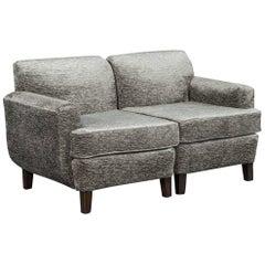 Opposing Modern Lounge Chairs in Plush Grey