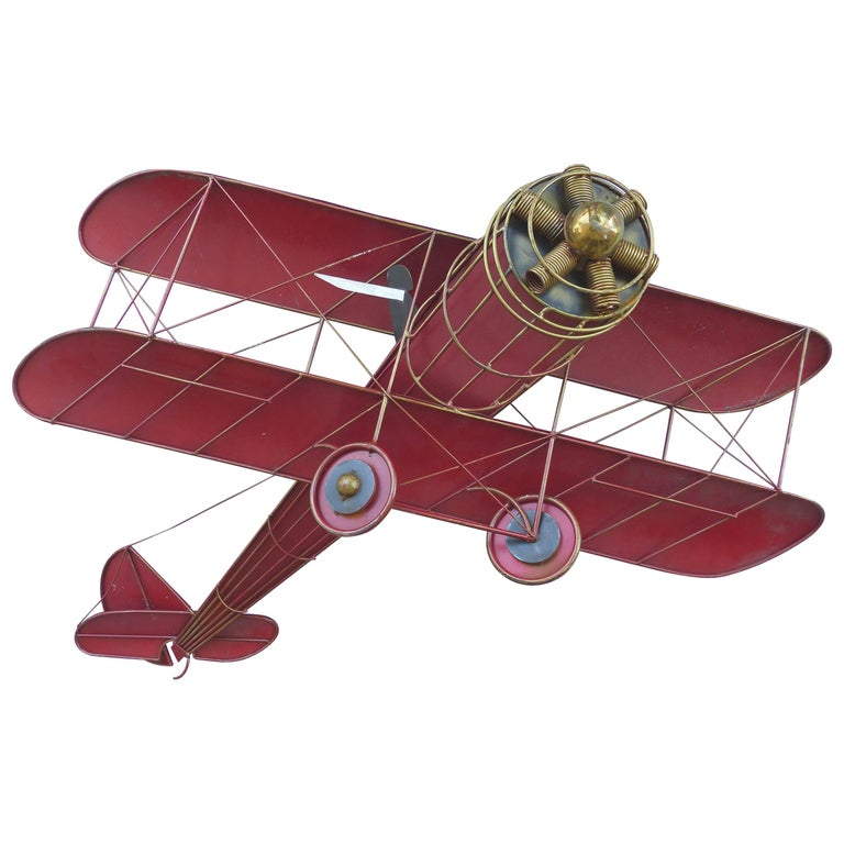Large Three Dimensional Iron and Brass Wall Sculpture of an Airplane in Flight