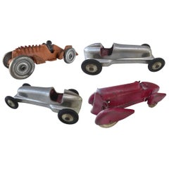 Collection of Four 1930s Metal Streamline Toy Cars