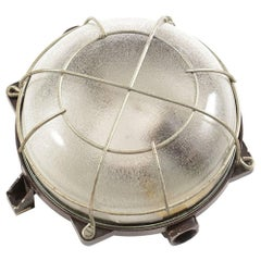 Industrial Ceiling/Wall Light in Bakelite and Glass with Metal Cage, circa 1950