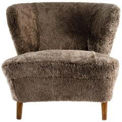 Scandinavian Vintage Armchair, circa 1930 in Curly Lambskin Upholstery