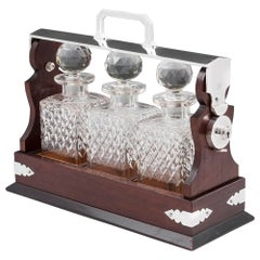 Antique Mahogany Silver-Plate Three Bottle Crystal Glass Tantalus, 20th Century
