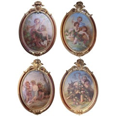 Set of Four Oval Paintings Depicting Cherubs at Play in the Four Seasons