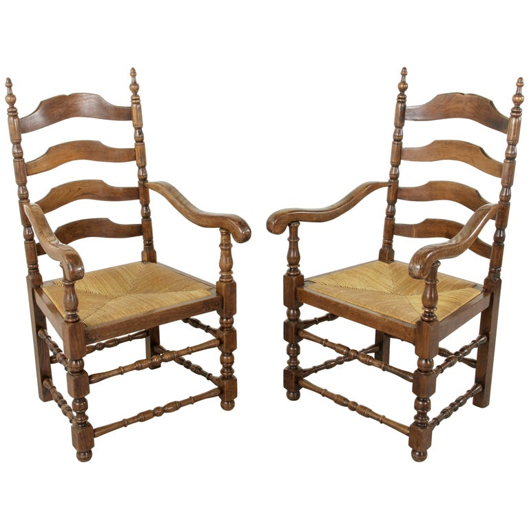Pair of Louis Philippe Style French Oak Ladder Back Armchairs with Rush Seats
