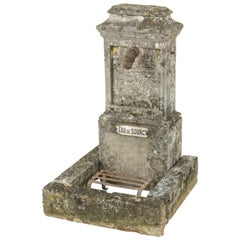 19th Century French Limestone Village Fountain with Iron Spout and Grate