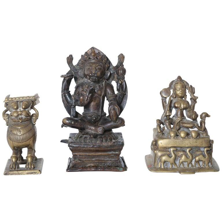 Three Tribal Bronze Sculptures, India and Sino-Tibetan, 17th-18th Century
