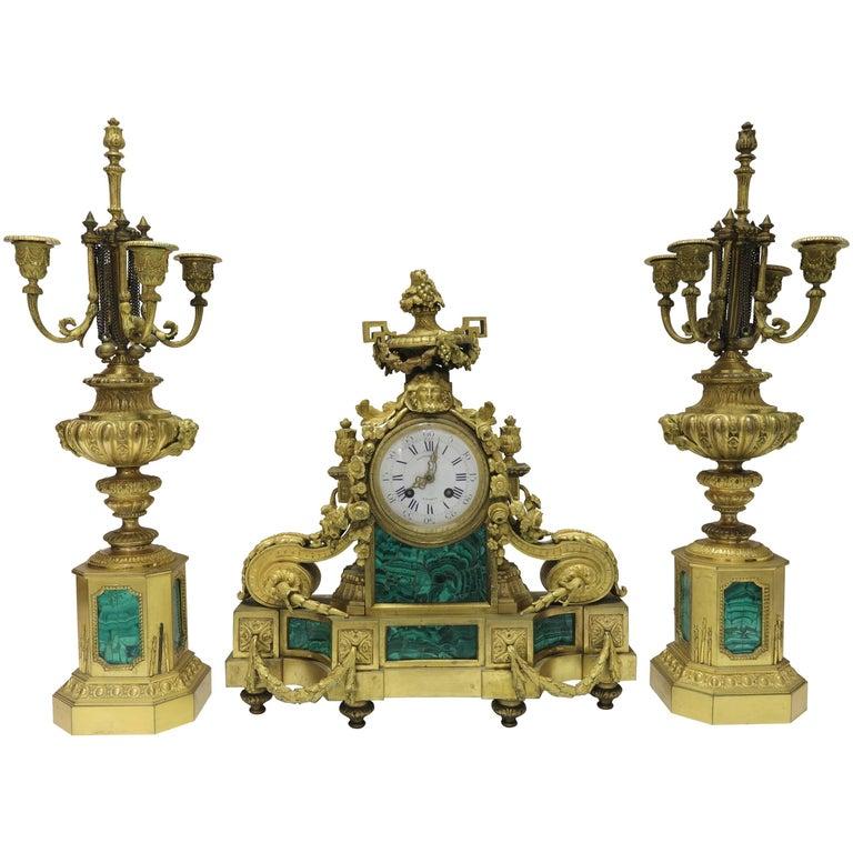 Three-Piece French Bronze and Malachite Clock Set