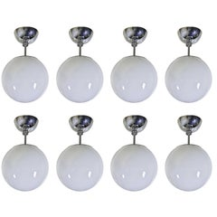 Set of Eight Midcentury Pendant Fixtures with Spherical Milk Glass Globes