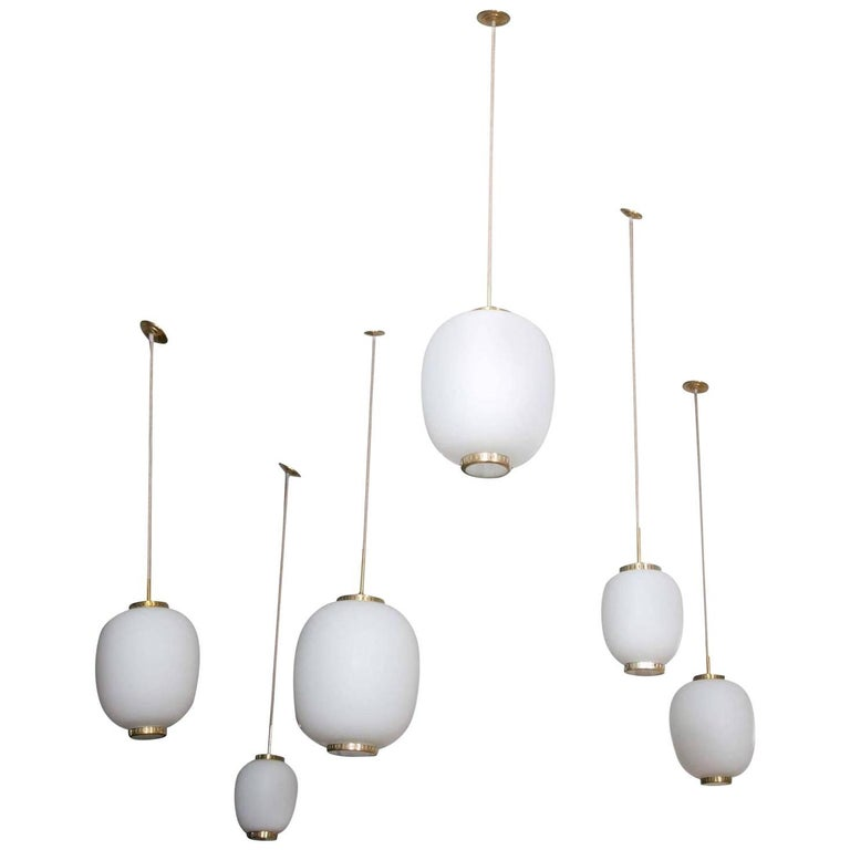 Collection of Seven Opaline Glass and Brass Ceiling Fixtures for Lyfa, 1950s