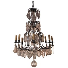 French Louis XVI Style Crystal and Iron Eight-Light Chandelier, 19th Century