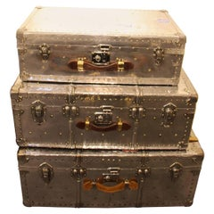 Stack of Three Polished Aluminium Steamer Trunks