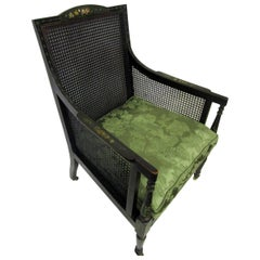 19th century English Regency Bergere Chair Painted Ebonized Wood and Cane