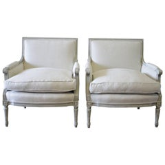 Pair of 20th Century Painted and Upholstered Louis XVI Style Bergere Chairs