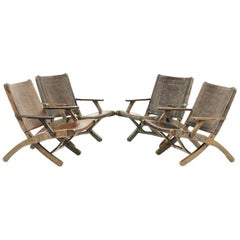 Four Folding Leather Armchairs