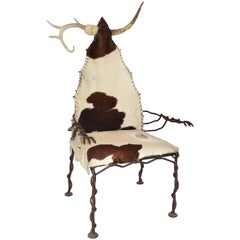 Western Arm or Lounge Chair in Wrought Iron Horn Antler and Cow Hide