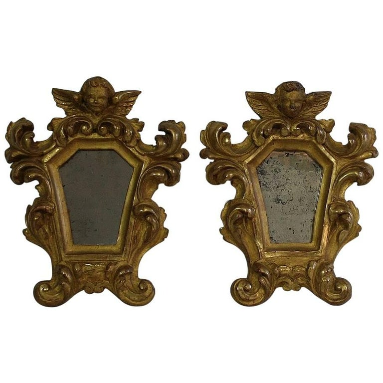 Pair of 18th Century, Italian Baroque Giltwood Mirrors