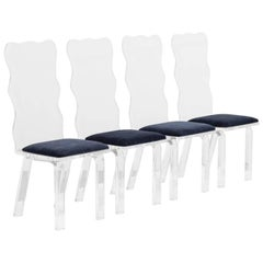 A Set of Four Waved Back Lucite Chairs 1980s