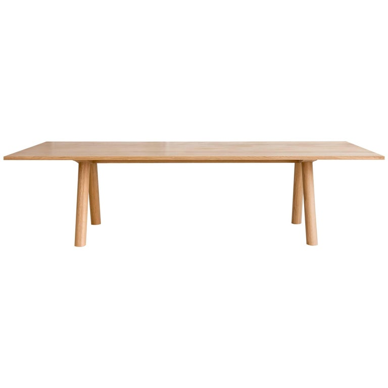 Contemporary Wood Angled Leg Column Dining Table In White Oak By