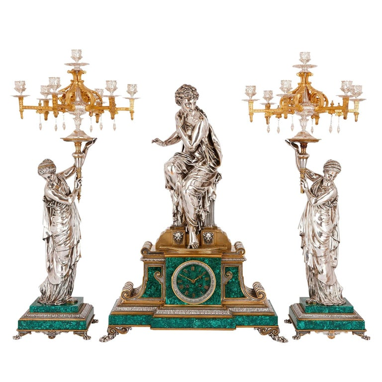French Clock Set in Malachite, Gilt and Silvered Bronze