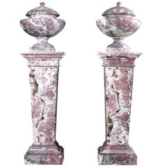 Pair of Grand Marble Urns on Column Plinths in the Neoclassical Style