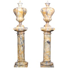 Pair of Vintage Grand Marble Urns on Column Plinths in the Neoclassical Style