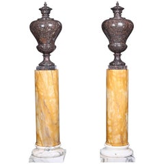 Vintage Grand Pair of Marble Urns on Column Plinths in the Neoclassical Style
