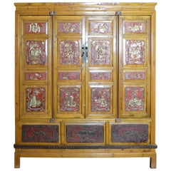 19th Century Qing Dynasty Chinese Hand-Carved Armoire with Gilt Painted Panels