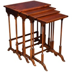 Nest of Four Mahogany Inlaid Tables