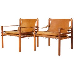 "Pair of ""Sirocco"" Safari Chairs in Caramel Leather by Arne Norell"