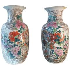 A large pair of 19th century Imari vases.