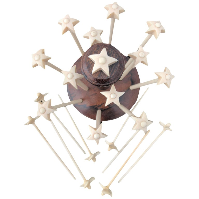 Ivory Champagne Mosers, 12 Hand-Carved Stars Eight Propellers with Star Stand