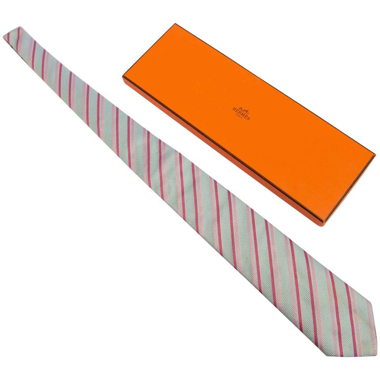 Hermès Silk Tie Made in Paris, France in Pink, Red and Yellow and Blue Hues
