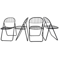 Black Metal Set of Four Folding Chairs
