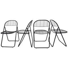 Black Metal Set of Four Folding Chairs