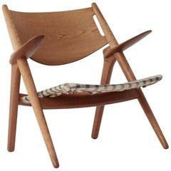 Hans Wegner CH28 Oak Sawbuck Armchair, 1950s, Denmark