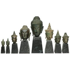 19th Century Collection of Mounted Bronze Thai Buddha Heads, circa 1800s
