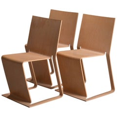Three Stacked Swedish lForm Chairs