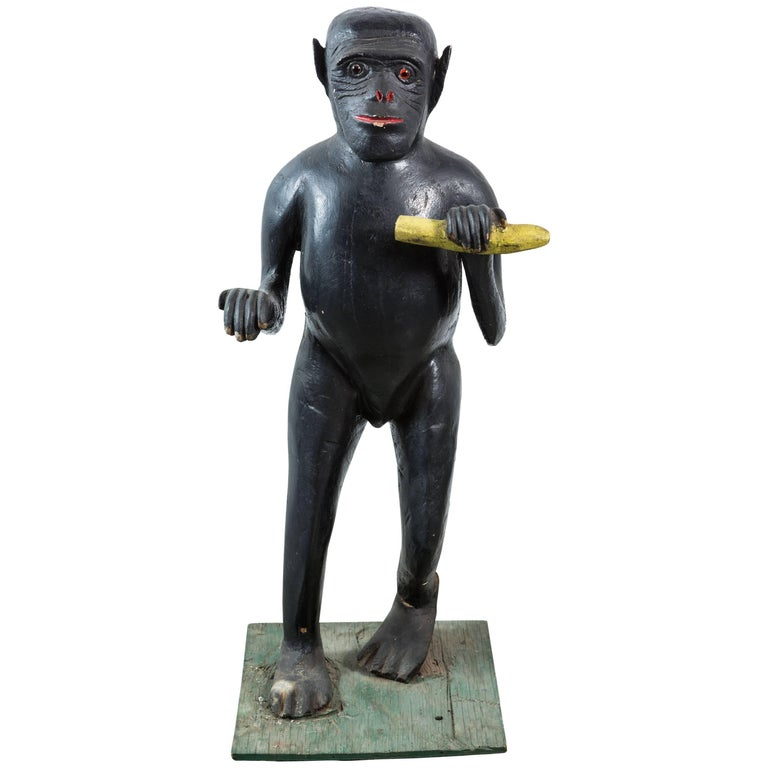 Vintage Life-Sized Folk Art Wood Monkey and Banana Carving with Glass Eyes For Sale